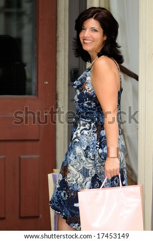 Pretty Woman Returning Home With New Fashion Clothes - stock photo