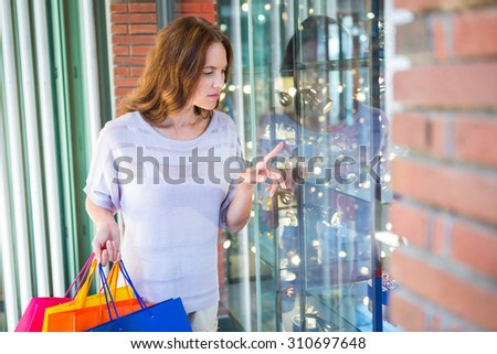 Pretty woman shopping at the mall on a sunny day