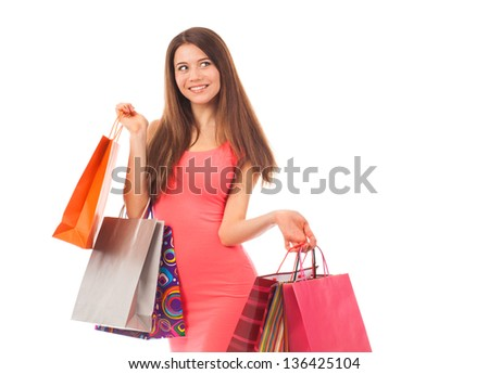Pretty woman shopping, holding shopping bags, isolated on white