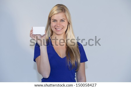 Pretty woman showing a card