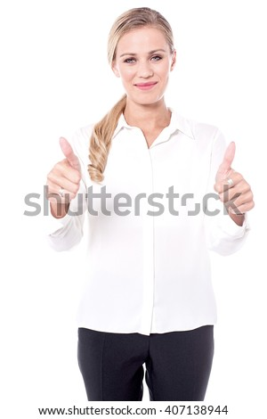 Pretty woman showing double thumbs up - stock photo