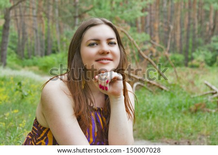 Pretty woman sitting in the forest