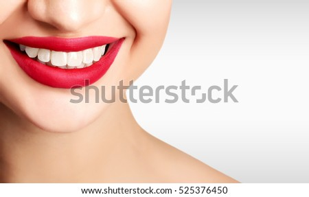 Pretty woman smile against a grey background with copyspace