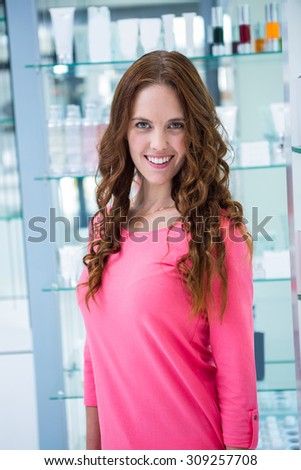 Pretty woman smiling at camera at the pharmacy
