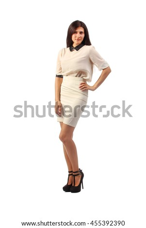 Pretty woman snaps in formal wear isolated on white