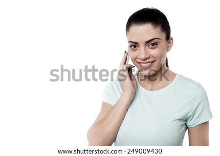 Pretty woman talking on cell phone - stock photo
