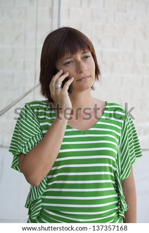 Pretty woman talking on mobile phone - stock photo