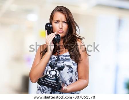 pretty woman talking on telephone - stock photo