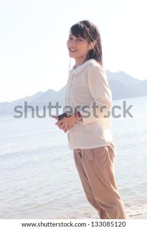 pretty woman using smartphone - stock photo