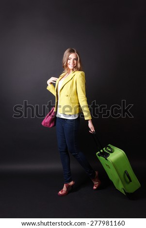 Pretty woman walking with a big baggage - stock photo