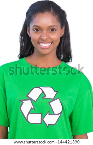 Pretty woman wearing green recycling tshirt on white background - stock photo