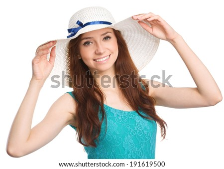 Pretty woman wearing summer hat, isolated over white - stock photo