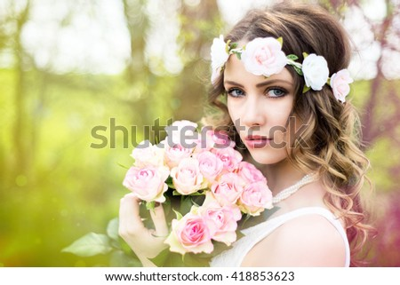 pretty woman with a bouquet roses / Woman with roses