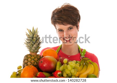 Pretty woman with assortment fresh fruit isolated over white background