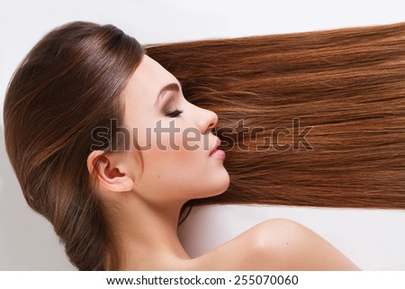 Pretty woman with beautiful long hair - stock photo