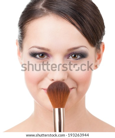 Pretty woman with cosmetic brush for powder, isolated on white - stock photo
