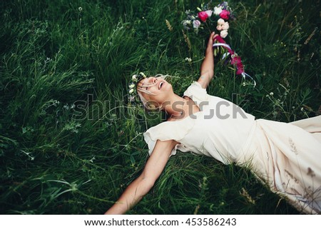 Pretty woman with flowers in the grass