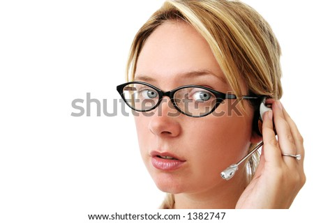 Pretty woman with glasses and hands free phone headpiece