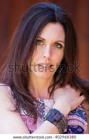 Pretty Woman with hand on her shoulder - stock photo