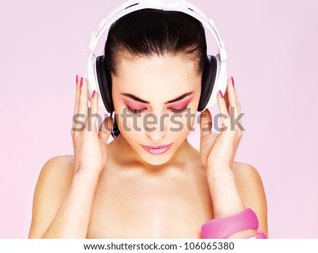 Pretty woman with headphones - stock photo