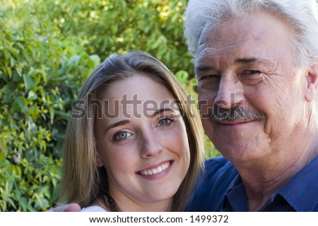 pretty woman with her handsome grandfather. - stock photo