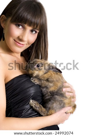 pretty woman  with her rabbit