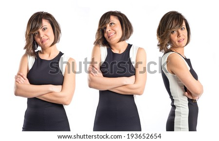 Pretty woman with his arms crossed over white - stock photo