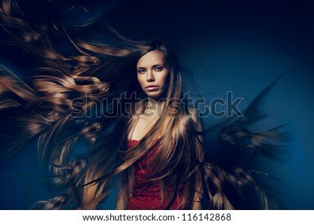 pretty woman with long fish hair - stock photo