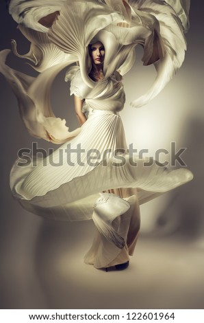 pretty woman with long flying dress - stock photo