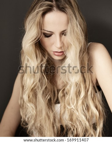 Pretty woman with long wavy blond hair