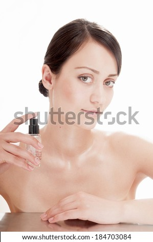 Pretty woman with serum for complexion skin. Skin care concept. - stock photo