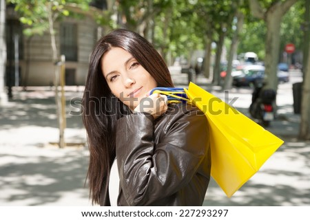 pretty woman with shopping bags at street in Madrid city Spain