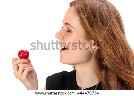 Pretty woman with strawberry in hand isolated on white
