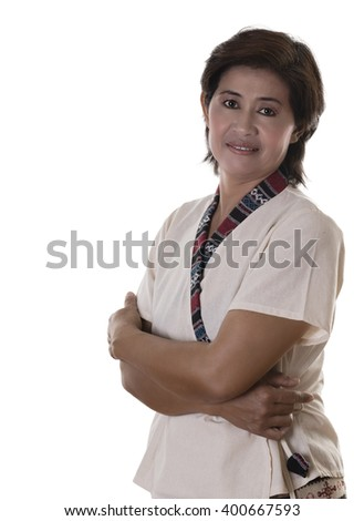 Pretty woman with white blouse and dark hair grins uncertainly while pressing crossed arms against her middle