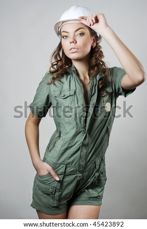 Pretty woman worker in white helmet - stock photo