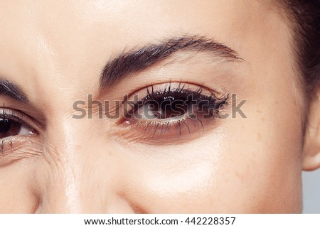 Pretty womans eye close up. beautiful brunette girl with no makeup, natural makeup