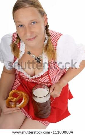pretty women in dirndl with pretzels and pint / munich beer festival - stock photo