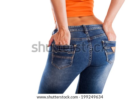 pretty women 's ass in tight jeans on white background