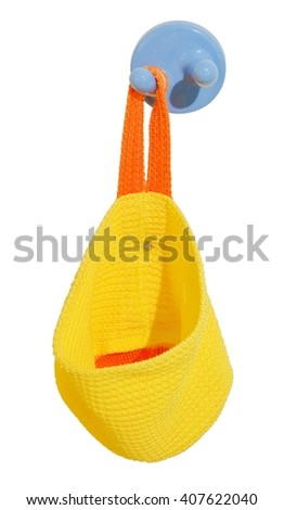 Pretty Yellow Knitted Bag Hanging on Plastic Wall Hook. - stock photo