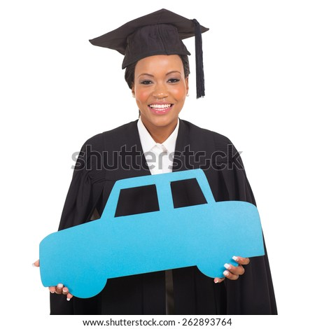 pretty young african american graduate holding a car symbol isolated on white - stock photo