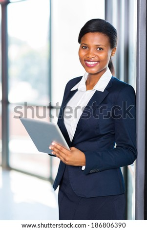 pretty young african american office worker using tablet computer - stock photo