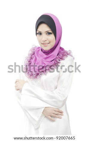 Pretty young Asian Muslim woman look polite in action. - stock photo