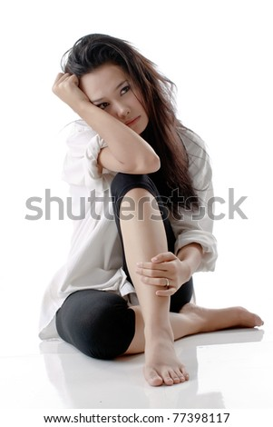 Pretty young beautiful Asian woman with stress looks against isolated white background - stock photo