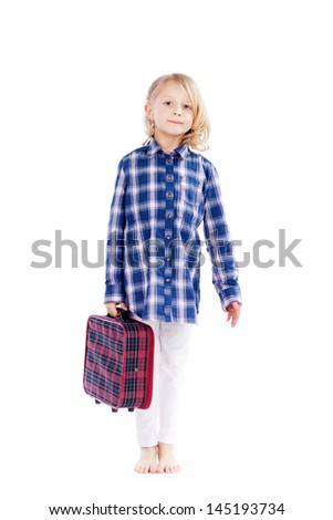 Pretty young blond girl carrying a small tartan suitcase in a blue checked shirt standing ready and waiting for her summer vacation isolated on white - stock photo