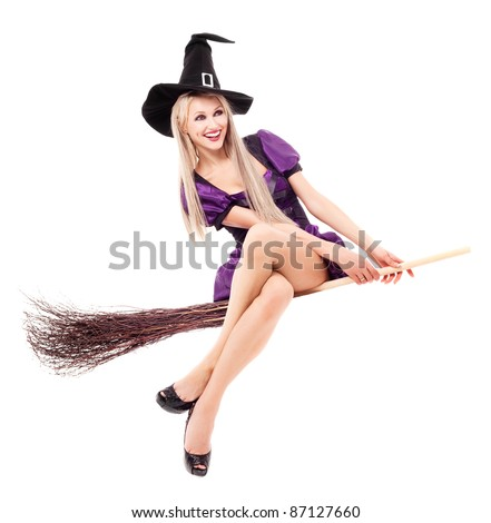 pretty  young blond witch flying on the broom, isolated against white background