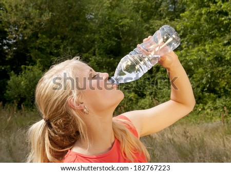 pretty young blond woman drinking water