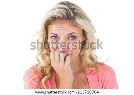 Pretty young blonde feeling nervous on white background - stock photo