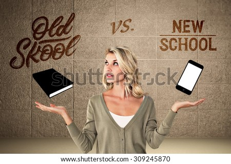 Pretty young blonde holding hands out against grey room - stock photo