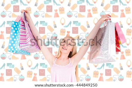 Pretty young blonde holding shopping bags against digital image of shopping doodles - stock photo