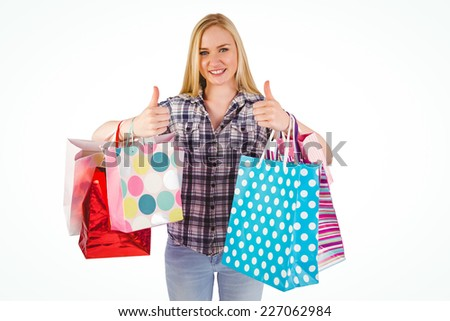 Pretty young blonde holding shopping bags on white background - stock photo